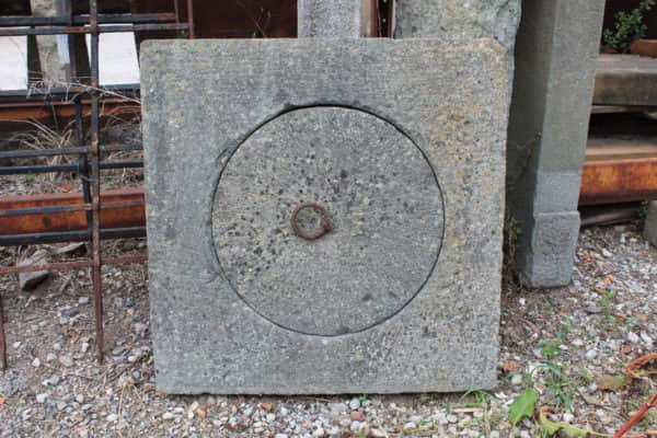 Manhole cover in stone