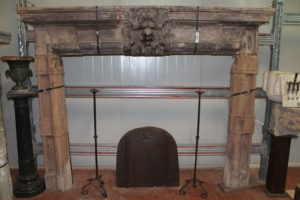 Antique gray sandstone fireplace