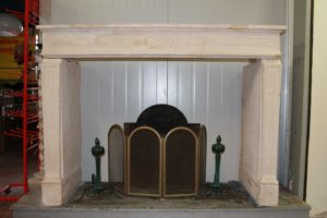 Antique light limestone fireplace